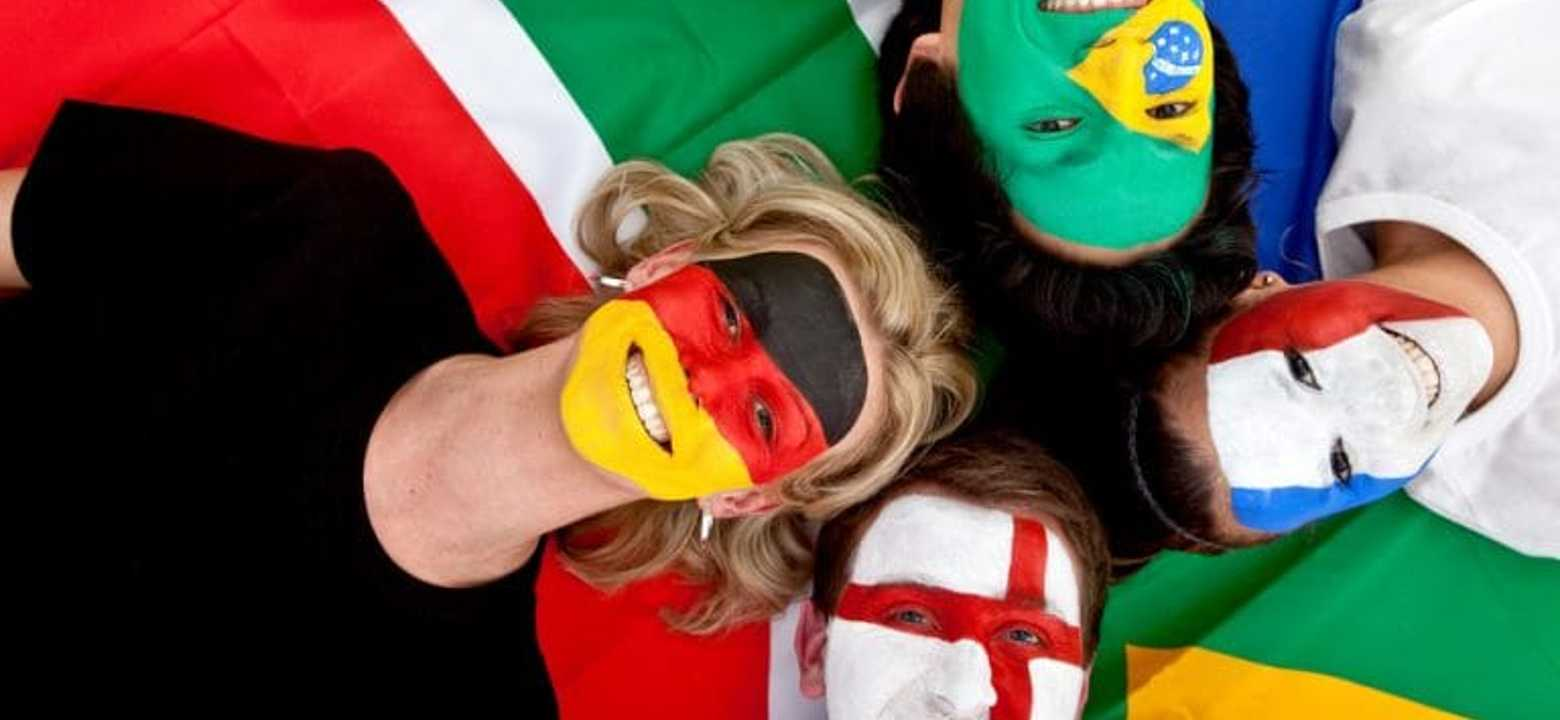 Students with facepainted flags